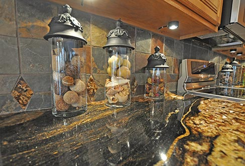 Supreme Surface has a well-earned reputation in their market for combining tasteful, exotic granite and stone with detailed and complete backsplash treatments.