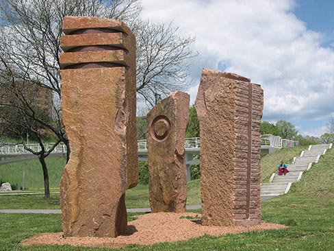 "Made from Wausau Red Granite, ""Sentinels"" was carved for the Brady Street Bridge Project, Milwaukee, Wisconsin in 2005. All three are approximately 15 feet tall, 4 feet wide and 4 feet deep."