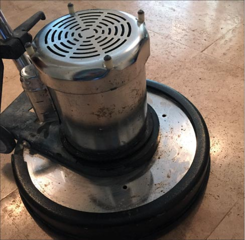 Use a splash guard on your floor machine to eliminate splatter on adjacent vertical surfaces. I also recommend doing a hot water rinse and buffing with a white pad to eliminate salt film residue.