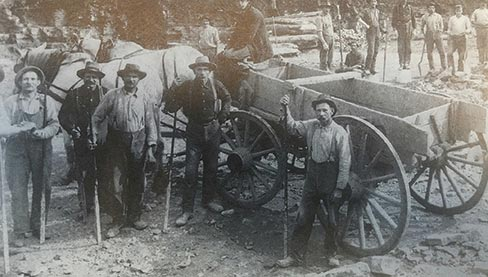 "Quarry men with the tools of their trade – chisels and pry bars – in one of the many Joliet quarries during the heyday. ""Initially, the quarries were shipping their stone by canal, but when the railroads came in, around the 1850s, the stone was also being shipped by rail,"" explained Barbara Newberg."