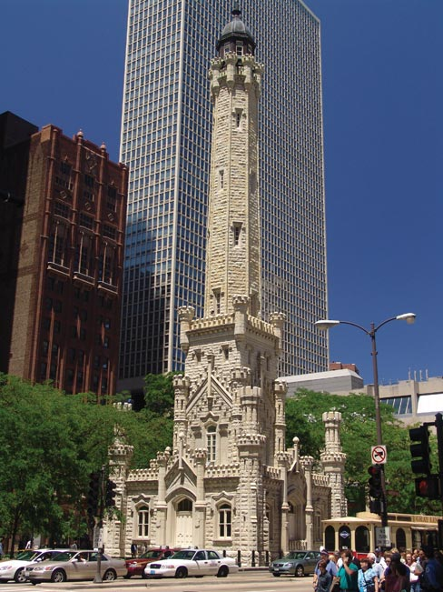 Completed  in 1869, the 154 ft. tall  Water Tower in downtown Chicago is built of Joliet buff and white Limestone. It is the only public building to survive the fire of 1871, although some stone had to be replaced  Behind the Neo-Gothic facade a 138-foot-tall standpipe (now removed) helped control the city's water pressure, when the city's supply was piped in from Lake Michigan. Now, the tower regulates the city's flow of tourists. Since the 1970s it has served as a tourist information office and also houses exhibits.