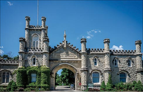 Entrance gate to the Rosehill Cemetery, Chicago, designed by W.W. Boyington. The Gothic Revival crenelated walls and towers were built with Joliet limestone about 5 years before the Chicago Water Tower, c.1864.  Rosehill is the largest cemetery in Chicago, with memorials to the Union and Confederate soldiers buried there. It contains the largest number of Union soldiers buried in any private cemetery in the U.S.