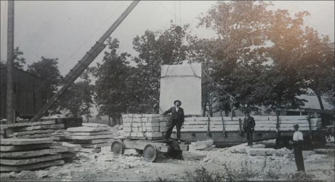 This unidentified Joliet quarry is using one of the high-tech cranes of the day, loading slabs onto a flatcar. Most likely the stone was destined to be fabricated into facades and foundations.