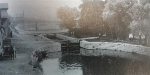 "An Illinois & Michigan Canal lock and the lock tender's house, in Joliet. The lock was removed in March, 1899. ""And then there's the beauty of the old canal locks. It's pretty amazing to see how they worked. Unfortunately this old lock in Joliet was removed when the canal was improved,"" explained Barbara Newberg."