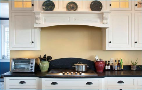 This beautiful Soapstone kitchen features an arched backsplash.