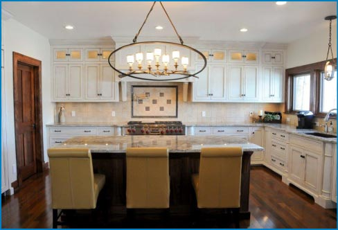 This kitchen features a Bianco Romano countertop which truly reflects all the natural sunlight from the surrounding landscape.