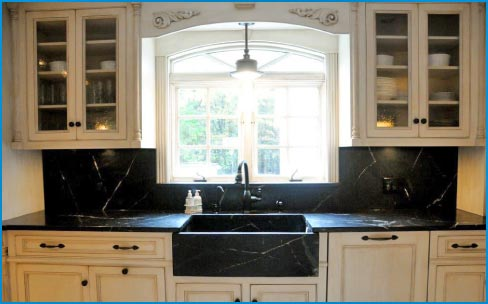 Detail view shows the soapstone countertops and the custom slant front sink.