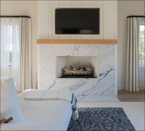Transitional-style fireplace showcases Pearl Grey Marble