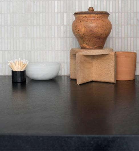 "Gibson chose to give her soapstone countertops a wax finish, to darken the surface and make it ""saturated and rich."""