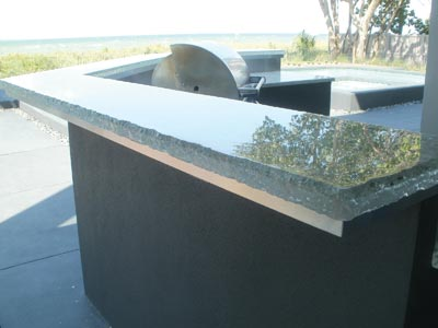 This intricate countertop was designed to make use of the customer's tile and resourcefully uses recycled windshields