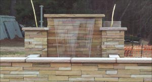 This Crab Orchard stone stacked waterfall definitely needs impregnating or color enhancing. Crab Orchard is  a dense, very hard  limestone from the Cumberland Plateau, in Central Tennessee and is an excellent structural stone.