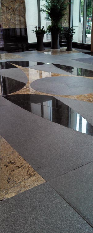 Flamed granite mixed with polished granites makes an excellent contrast for paving, but the maintenance can be a little challenging,