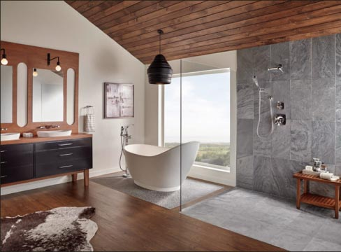 Montauk Black Slate large format tiles are an elegant focus in this open plan bath.