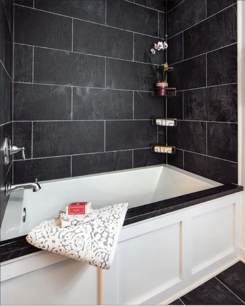 Soapstone is a striking and unusual choice for a bathroom. Generally, darker surfaces are less likely to stain, but all natural stone surfaces used in bathrooms should be sealed to prevent staining, and resealed once a year.
