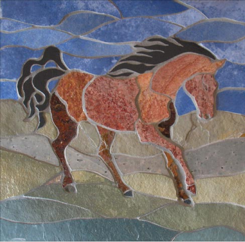 A Horse For Terry is 16  by 18 inches, assembled from complementary shades of slates and blue ceramic. This detail shows how Tholberg uses subtle textures and colors in her work.