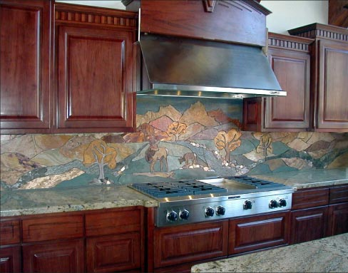 Elkville is a full-height, 19-foot-long backsplash mural made out of travertine, marble, slate, porcelain, sandstone and pebbles. Installed in a private residence in Pagosa Springs Colorado.