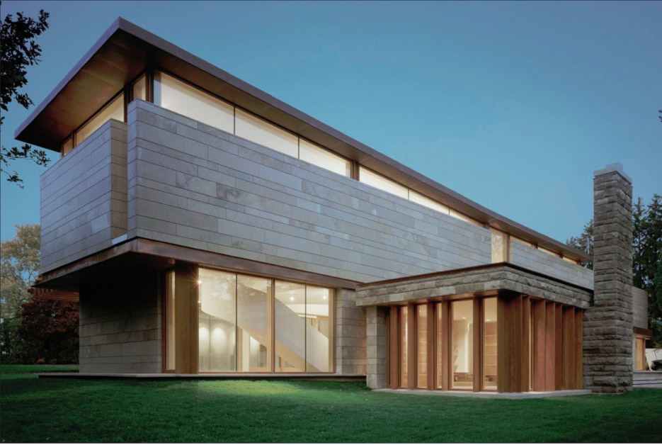 Honed Algonquin Fleuri limestone panels clad this sleek modern residence in Ontario.