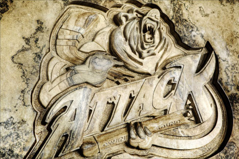 Deep bas-relief carving in a block of Algonquin limestone, for the Owen Sound Attack hockey club shows the typical earth tones and grain variations found in this beautiful stone.