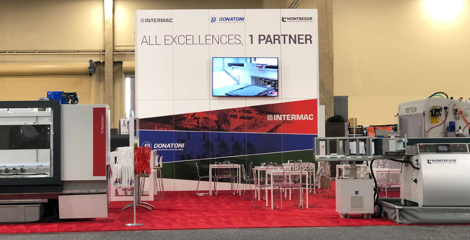 The Intermac booth at 2020 StonExpo showcased several machines and new technology like the EasySTONE CAD program and the SOPHIA IoT platform.
