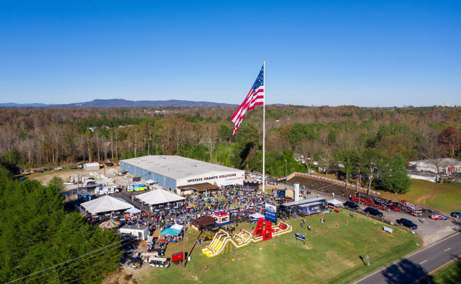 Drone camera footage captured the 50 by 80 foot flag rising up the flagpole at the Veteran's Day and flag dedication ceremony.