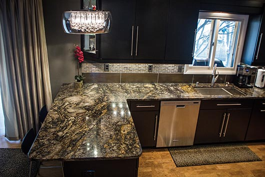 Brown's client, Mrs. Shaffer, chose placement of the cuts and movement in the granite according to how the lights would hit it. The Shaffers love the shine and color of the Cianitus, which can be very difficult to work with because of its softness and high quartz composition.