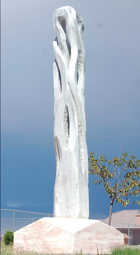 """Quantum Movement"" is a 121 inch high x 40 inch wide x 22 inch deep sculpture made in 2011 and, according to Eino, is made from Georgia marble. It is a continuation of Eino's ""Woven Series"" and appears as continuous ribbons from top to bottom."