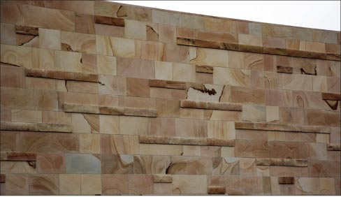 This wall at the Blue Ash Summit Park incorporates a sawed veneer with a cropped, split face rubble to give the wall a rich color variation and also a nice depth and reveal.