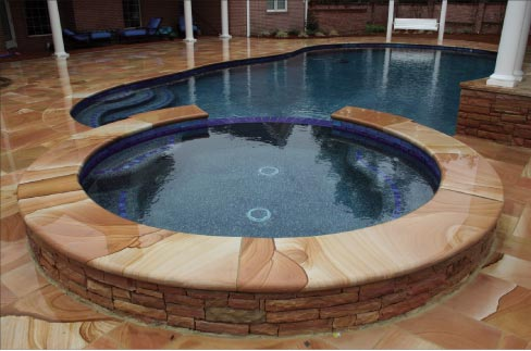 Silvara does several large, custom pool projects every year. This project in South Georgia incorporates Silvara's sawed paving with radius, bullnosed coping on the spa area.