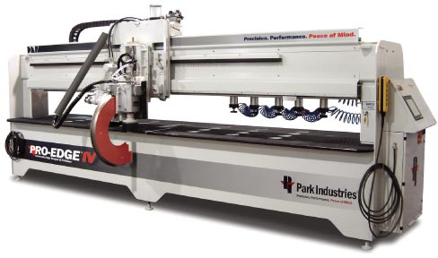 "The Park Industries Pro-Edge was introduced in 1992.  The Pro- Edge was not the first ""C"" frame machine on the market, but Park was the first to make one that reliably produced several toroidal edges with precision, and it revolutionized edge shaping and speed in the shop. The Pro-Edge IV is the latest and greatest."