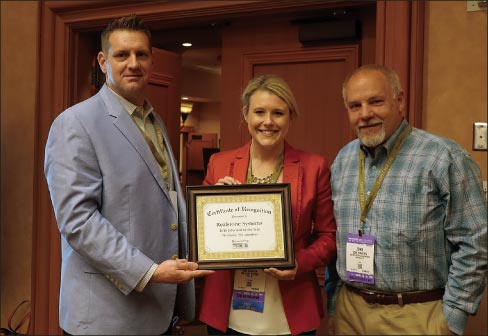 Shea Quarton and John Striednig (center and right) accept the 2016 Educator of the Year Award from MIA+BSI Education Committee Chair, Rob Bacon (Daltile).