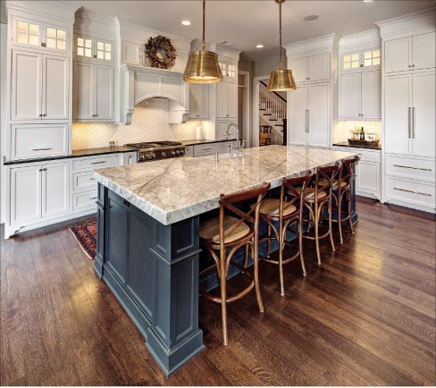 This stunning kitchen features a Carrara marble island with 3-inch mitered edge, and Nero Orion on the perimeter countertops.