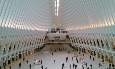 The Oculus, a calming expanse of soaring white marble ribs, is part of the 9/11 site, located next to the footprint of the fallen towers.