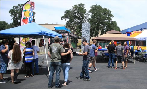 Employee appreciation picnic complete with rock wall, bounce house, and taco truck!