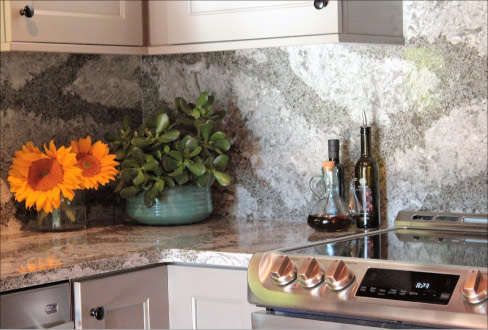 The bookmatched, full height backsplash and countertops are fabricated in Galloway Quartz, from Cambria's Coastal Collection.