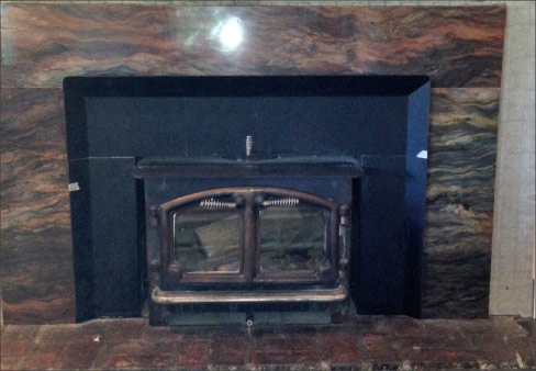 Residential fireplace surround fabricated in quartz;