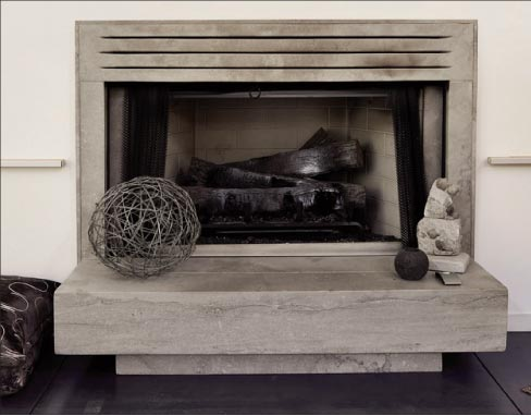 Modern style fireplace showcasing the Napoleon cut;  design and fabrication by Freddie Flores.