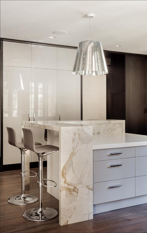 """This remarkably clean, crisp, modern gourmet kitchen is a celebration of functional design and stunning aesthetics."""