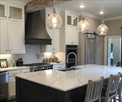 Metro Quartz Calacatta Sienna graces this large-scale island and countertops. Subway tile completes the modern, clean look.