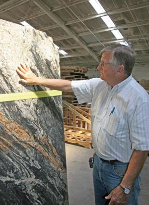 Kirby Webb Inspects a slab of Magma textured granite at Craftstone Products in Soddy-Daisy, TN