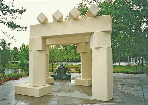 This Cordova Creme limestone structure was fabricated by Southern Granite Company, Inc., for a scenic meditation area on a lake-island park on the grounds of the Mayo Clinic hospital in Jacksonville, Florida. The Southern Granite Co. also supplied the granite ball fountain. The lattice is approximately 17x17 foot, with the upper segments supported by three columns set on 18 inch-high, rectangular bases, one free-standing. Set on angles, no two exactly alike, it weighs 126 tons and can withstand winds up to 180 miles per hour.