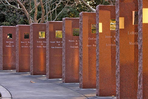 "The flagpole is set in a base decorated by the artwork of children whose drawings were glazed onto ceramic tiles. A serpentine row of ""Wausau Red"" tablets commemorates each passenger lost on Flight 93 the morning of September 11, 2001 in Somerset County, Pennsylvania. A polished stainless steel plate is fixed in each tablet at eye level to remind viewers that any one of us could have been on that flight. EGA members donated the time, work, supplies and material."
