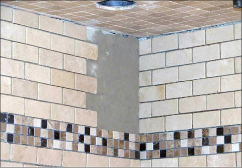 Tiles with resin-coated back are a failure waiting to happen in vertical installations – just say no! Instead, use fiberglass-backed tiles for safety and peace of mind.