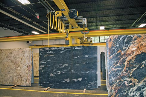 Elite Stone Imports have ably maximized their floor space by using two overhead cranes and two heavy duty lift trucks