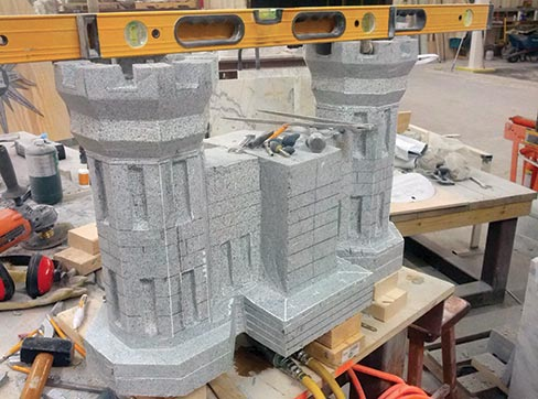 "The Elberton Blue granite castle under construction. ""The castle is the symbol of the Army Corps of Engineers, which the Marines adopted many years ago The Marine Corps mounted the EGA to the front of it to show that it is the Marine Corps version of it, obviously,"" said Stan."