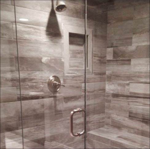 Large Format Porcelain Tiles Inside A Seamless Glass Enclosure Give Transition Between The Shower And Rest Of Bathroom