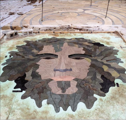 "Prefitting the mosaic at the studio: ""There were two things going on at the same time – fitting, and a color check. Then, most of the pieces of the leaf were epoxied onto diamond pattern lath. That's how we did the perimeter where the face meets the background. We could build it in our shop, transport it, and install it anywhere."""