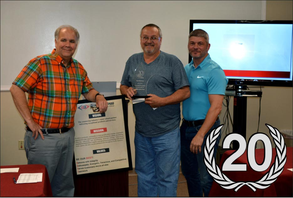 Above,  center: Jack Harrison, Braxton-Bragg Warehouse Shipping/Receiving is recognized for 20 Years of Service with Braxton-Bragg. Presented by CFO Dave Jester (left) and CEO Rick Stimac (right).