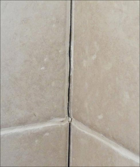 "I inspected the shower and found a classic case of grout failure. Corner seams or direction transitions need a ""soft joint,"" with a more flexible material."