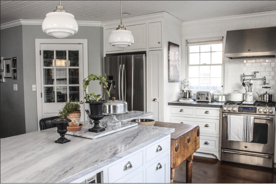 Honed White Cherokee marble is the perfect antique surface for a remodeled, modernized turn-of-the-century kitchen.