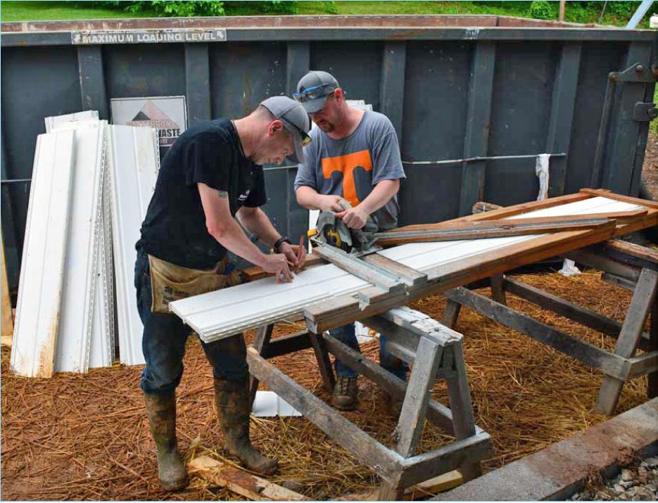 Braxton-Bragg volunteers Matt Maples (left) and Jeff Dykstra trim siding to size at the Habitat for Humanity jobsite.